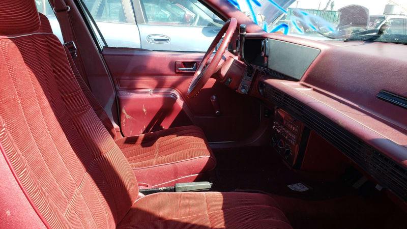 48 1987 Chevrolet Corsica in Colorado junkyard photo by Murilee Martin