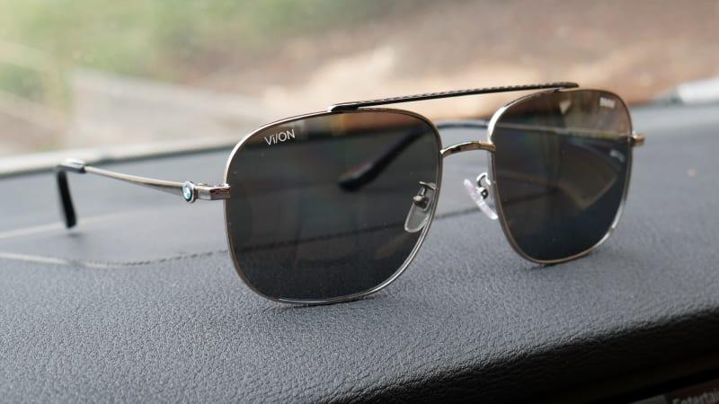 BMW sunglasses on dash