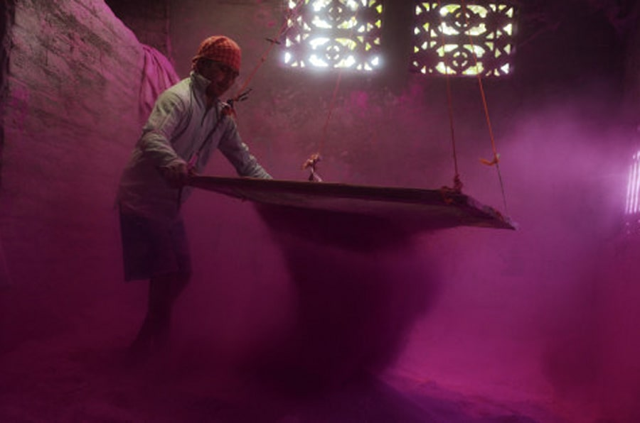 An Indian labourer sifts coloured powder, known as 'gulal', to be used during the forthcoming spring festival of Holi, inside a factory at Fulbari village on the outskirts of Siliguri on March 9, 2014. Holi, the popular Hindu spring festival of colours is observed in India at the end of the winter season on the last full moon of the lunar month and will be celebrated on March 16 this year.  AFP PHOTO /Diptendu DUTTA        (Photo credit should read DIPTENDU DUTTA/AFP/Getty Images)