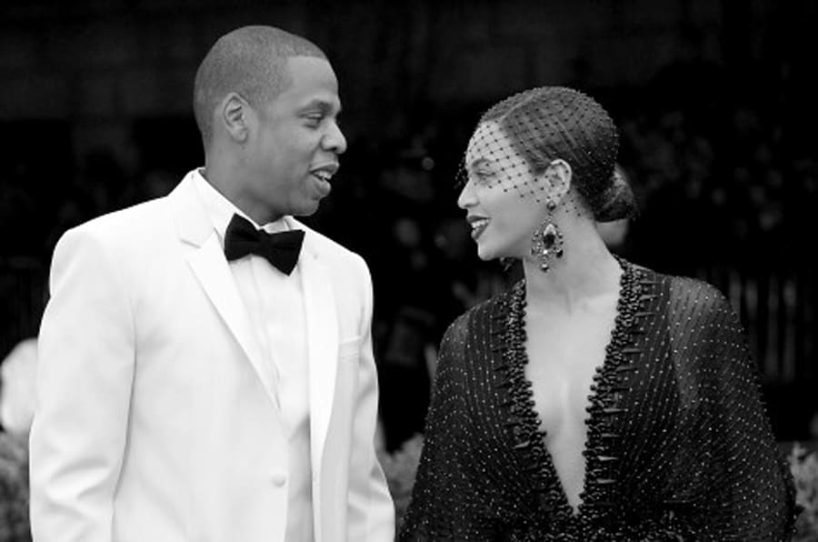 NEW YORK, NY - MAY 05: (EDITORS NOTE: Image was converted to black and white.)   Jay-Z (L) and Beyonce attend the 'Charles James: Beyond Fashion' Costume Institute Gala at the Metropolitan Museum of Art on May 5, 2014 in New York City.  (Photo by Mike Coppola/Getty Images)
