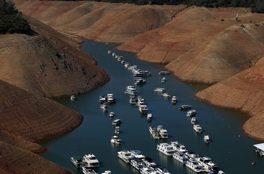 OROVILLE, CA - AUGUST 19:  House boats are dwarfed by the steep banks of Lake Oroville that used to be under water on August 19, 2014 in Oroville, California. As the severe drought in California continues for a third straight year, water levels in the State's lakes and reservoirs is reaching historic lows. Lake Oroville is currently at 32 percent of its total 3,537,577 acre feet.  (Photo by Justin Sullivan/Getty Images)