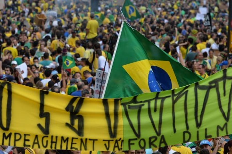 Demonstrators rally to protest against the government of president Dilma Rousseff in Paulista Avenue in Sao Paulo Brazil on 15 March 2015. Thousands of demonstrators clad in the yellow-green national colours protested Sunday in several cities of Brazil against president Dilma Rousseff who is facing a complex economic panorama and a political corruption scandal.  AFP PHOTO / NELSON ALMEIDA        (Photo credit should read NELSON ALMEIDA/AFP/Getty Images)