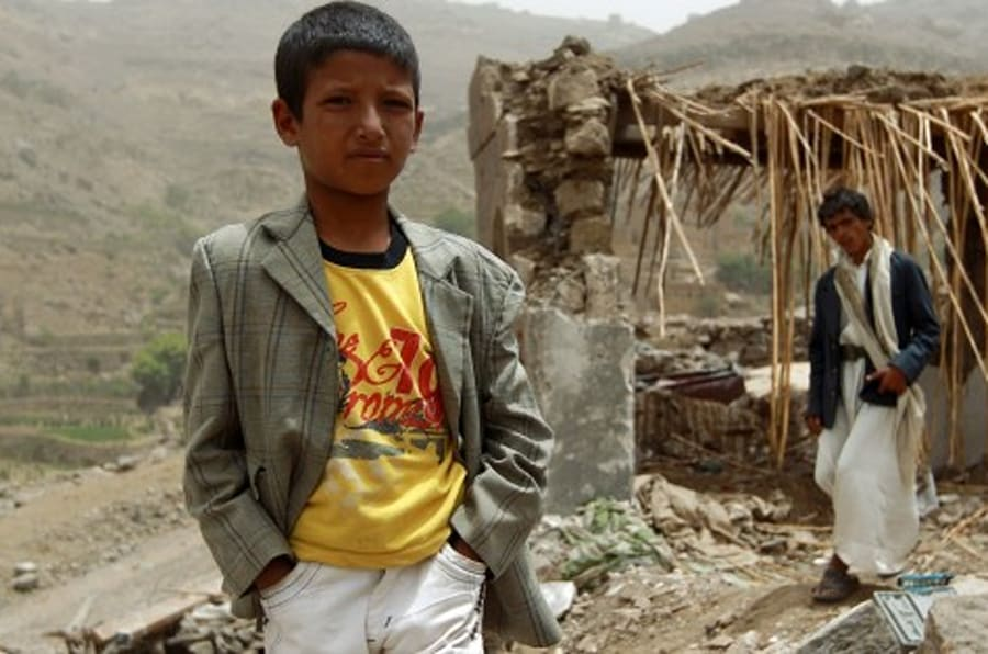 A Yemeni boy stands in front of a damaged house in the village of Bani Matar, 70 kilometers (43 miles) West of Sanaa, on April 4, 2015, a day after it was reportedly hit by an airstrike by the Saudi-led coalition against Shiite Huthi rebel positions. A Saudi-led coalition pounded rebels in southern Yemen and dropped more arms to loyalist fighters as the UN Security Council prepared to discuss calls for 'humanitarian pauses' in the air war.   AFP PHOTO / MOHAMMED HUWAIS        (Photo credit should read MOHAMMED HUWAIS/AFP/Getty Images)