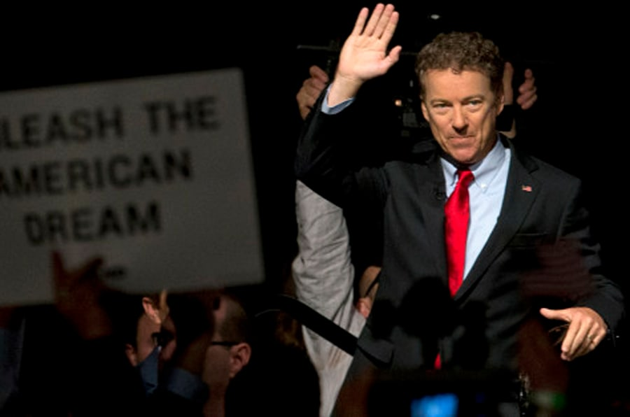 """Sen. Rand Paul, R-Ky. waves as he arrives to announce the start of his presidential campaign, Tuesday, April 7, 2015, at the Galt House Hotel in Louisville, Ky. Paul launched his 2016 presidential campaign Tuesday with a combative message against both Washington and his fellow Republicans, declaring that """"we have come to take our country back."""" (AP Photo/Carolyn Kaster)"""