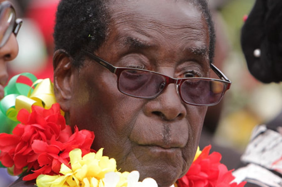 President Robert Mugabe is seen during celebrations to mark his 91st birthday in the resort town of Victoria Falls, Zimbabwe, Saturday Feb, 28, 2015. Mugabe turned 91 on the 21st of February and become the world's oldest leader, with his supporters saying they will back him to run his full term until 2018 - despite questions about his health and an economy that is crumbling under his watch. (AP Photo/Tsvangirayi Mukwazhi)