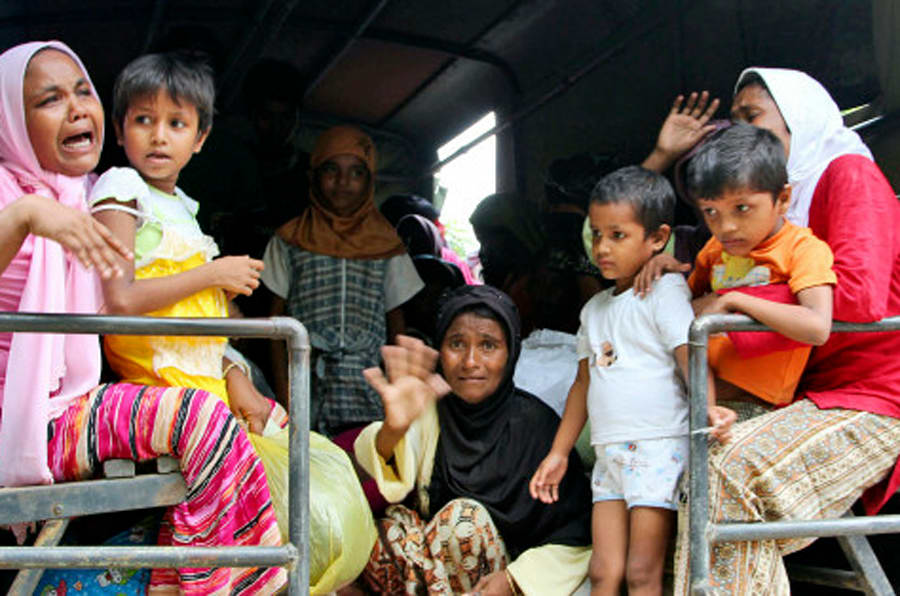 Ethnic Rohingya women and children whose boats were washed ashore on Sumatra Island board a military truck to be taken to a temporary shelter in Seunuddon, Aceh province, Indonesia, Sunday, May 10, 2015. Boats carrying about 500 members of Myanmar's long-persecuted Rohingya Muslim community washed to shore in western Indonesia on Sunday, with some of the people in need of medical attention, a migration official and a human rights advocate said. (AP Photo/S. Yulinnas)