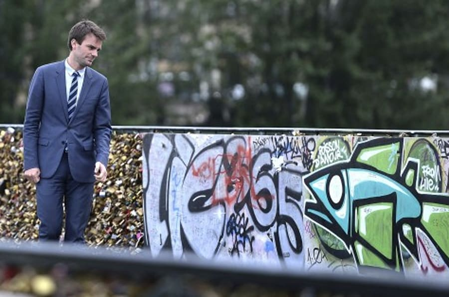 Paris Deputy Mayor Bruno Julliard stands on the Pont des Arts during the removal of love padlocks attached on the railings of the bridge on June 1, 2015 in Paris. Started by tourists in Paris in 2008, the love locks ritual, which also spread in the early 2000s to cities including New York, Seoul and London, has resulted in the transformation of several bridges : every inch of their railings is now covered with clunky brass padlocks. AFP PHOTO / STEPHANE DE SAKUTIN        (Photo credit should read STEPHANE DE SAKUTIN/AFP/Getty Images)