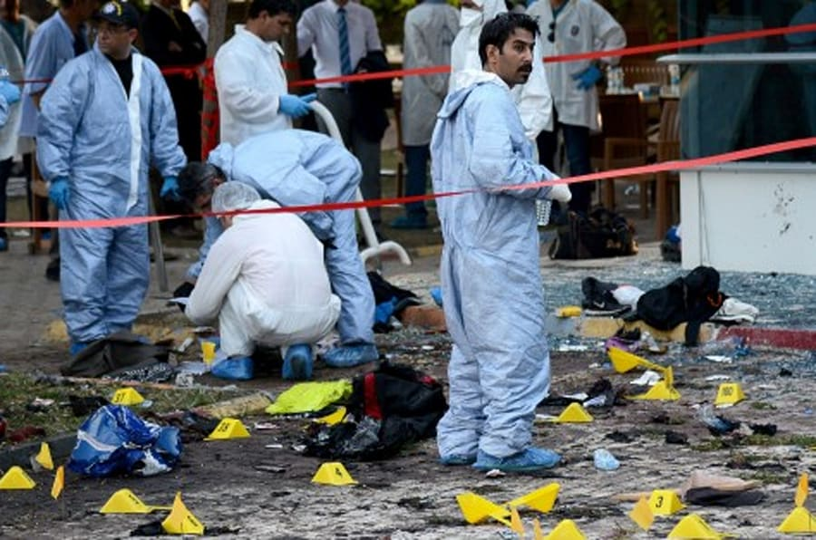 Turkish forensic investigators work at the site of a suicide bombing which killed at least 31 on July 20, 2015 in the Turkish town of Suruc near the border with Syria. A suspected Islamic State suicide bomber killed at least 31 people on July 20 in an attack on a Turkish cultural centre where activists had gathered to prepare for an aid mission in the nearby Syrian town of Kobane.    AFP PHOTO / ILYAS AKENGIN        (Photo credit should read ILYAS AKENGIN/AFP/Getty Images)