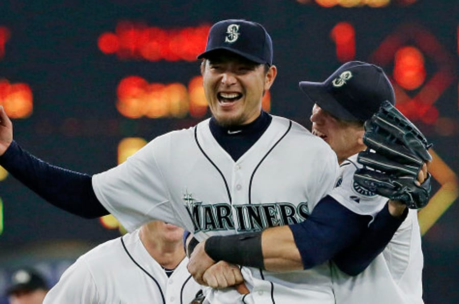 Seattle Mariners starting pitcher Hisashi Iwakuma is hugged by first baseman Logan Morrison, right, after the final out of Iwakuma's no-hitter against the Baltimore Orioles in a baseball game Wednesday, Aug. 12, 2015, in Seattle. The Mariners won 3-0. (AP Photo/Ted S. Warren)