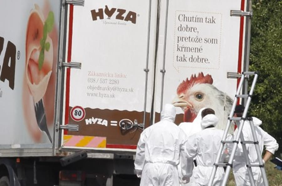 Forensic officers stand in front of a truck inside which were found a large number of dead migrants on a motorway near Neusiedl am See, Austria, on August 27, 2015. The vehicle, which contained between 20 and 50 bodies, was found on a parking strip off the highway in Burgenland state, police spokesman Hans Peter Doskozil said at a  press conference with Interior Minister Johanna Mikl-Leitner. AFP PHOTO / DIETER NAGL        (Photo credit should read DIETER NAGL/AFP/Getty Images)