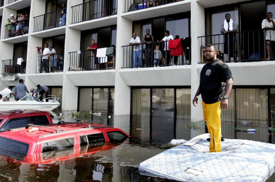 New Orleans Police and volunteers use boats to rescue residents from a flooded  neighborhood on the east side of  New Orleans, Wednesday, Aug. 31,  2005. Hurricane Katrina left much of the city under water.  Officials called for a mandatory evacuation of the city, but many resident remained in the city and had to be rescued from flooded homes and hotels.  (AP Photo/Eric Gay)