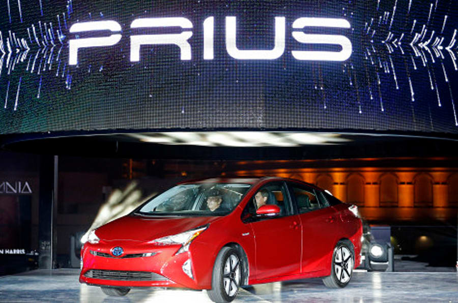 Toyota unveils the latest version of the Prius at an event Tuesday, Sept. 8, 2015, in Las Vegas. The car is still the No. 1 hybrid on the market but has been a tougher sell for dealers with gas prices below $3 in many areas of the country. (AP Photo/John Locher)