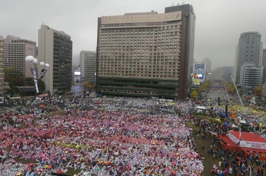 South Korean protesters stage a rally against government policy in Seoul, South Korea, Saturday, Nov. 14, 2015. Police fired tear gas and water cannons Saturday as they clashed with anti-government demonstrators who marched through Seoul in what was believed to be the largest protest in South Korea's capital in more than seven years.(AP Photo/Ahn Young-joon)