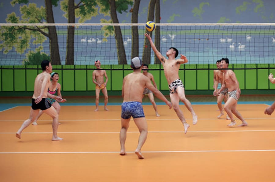 North Koreans dressed in their swim suits play a round of volleyball at the Munsu water park on Tuesday, Dec. 1, 2015, in Pyongyang, North Korea. The water park is opened to both tourists as well as locals living in the North Korean capital. (AP Photo/Wong Maye-E)