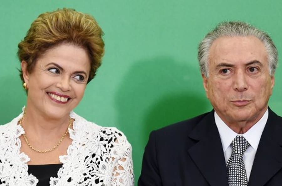 Brazilian President Dilma Rousseff (L) and her Vice-President Michel Temer attend the inauguration ceremony of new ministers at the Planalto Palace in Brasilia on October 5, 2015. 10 new ministers were sworn in after the cabinet reshuffle to shore up support for Rousseff's troubled coalition government. AFP PHOTO/EVARISTO SA        (Photo credit should read EVARISTO SA/AFP/Getty Images)