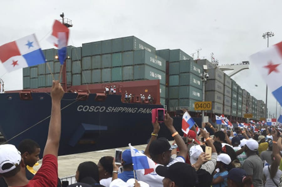 TOPSHOT - Chinese-chartered merchant ship Cosco Shipping Panama crosses the new Agua Clara Locks during the inauguration of the expansion of the Panama Canal in Colon, 80 km from Panama City on June 26, 2016 on June 26, 2016. A giant Chinese-chartered freighter nudged its way into the expanded Panama Canal on Sunday to mark the completion of nearly a decade of work forecast to boost global trade. / AFP / RODRIGO ARANGUA        (Photo credit should read RODRIGO ARANGUA/AFP/Getty Images)