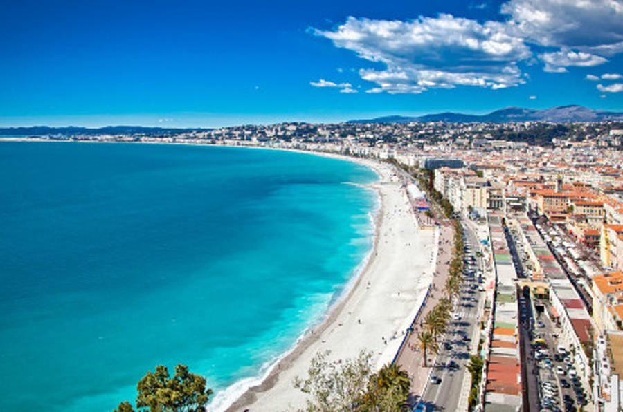 Panoramic view of Nice coastline and beach with blue sky, France.