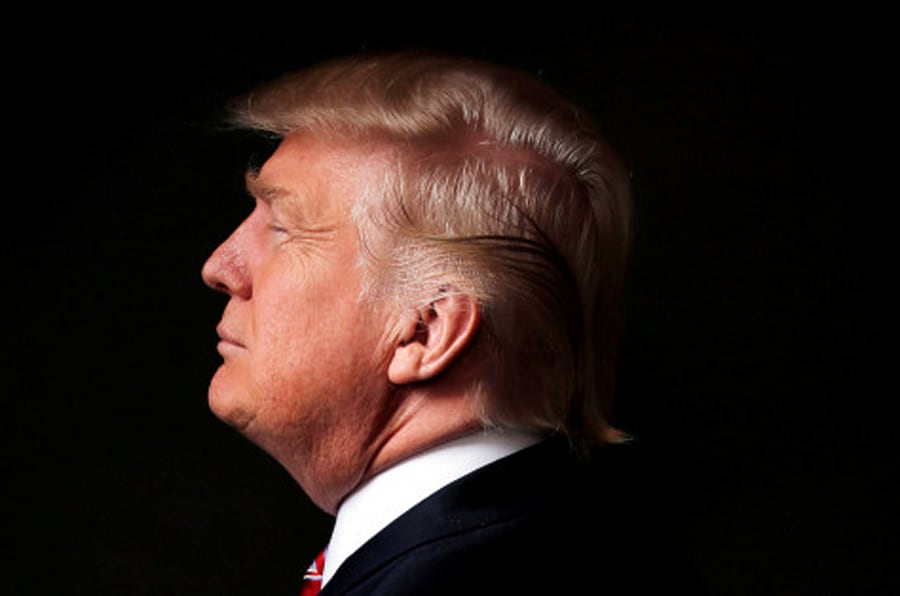 """Republican U.S. presidential candidate Donald Trump poses for a photo after an interview with Reuters in his office in Trump Tower, in the Manhattan borough of New York City, U.S., May 17, 2016. REUTERS/Lucas Jackson/File Photo                  FROM THE FILES PACKAGE """"THE CANDIDATES"""" - SEARCH CANDIDATES FILES FOR ALL 90 IMAGES"""