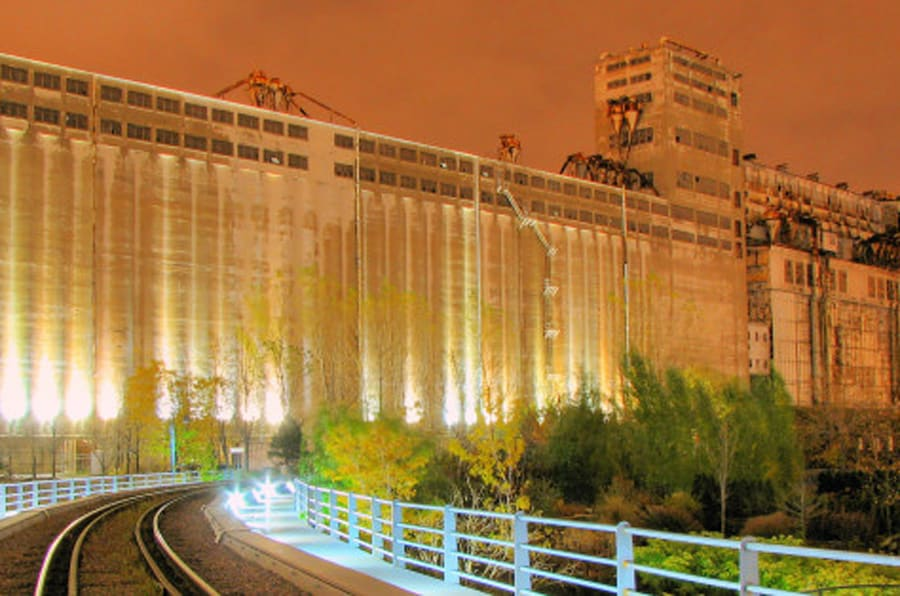 Large and familiar grain elevator complex located at foot of McGill Street and mouth of LachineCanal, popularly known as Silo No. 5, was built over period of more than fifty years, starting.