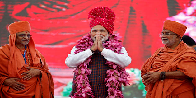 India's Prime Minister Narendra Modi greets his supporters during an election campaign meeting ahead of Gujarat state assembly elections, in Ahmedabad, India, December 3, 2017.