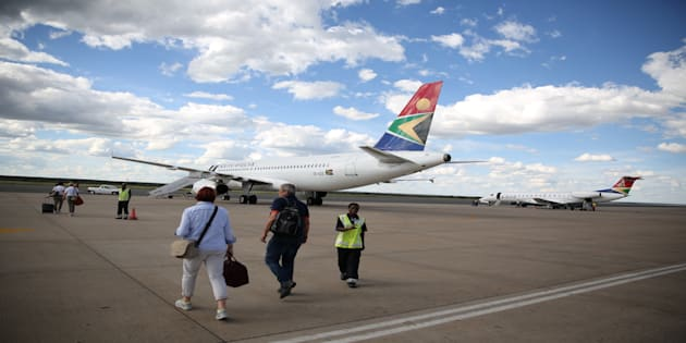 Passengers board a South African Airways the capital aircraft t the Hosea Kutako International Airport, outside Windhoek in Namibia, February 24, 2017.