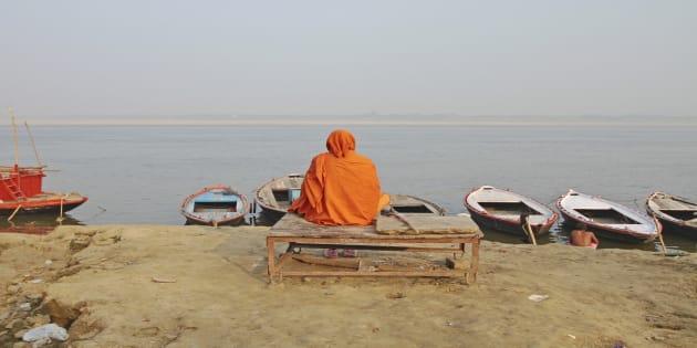 REPRESENTATIVE IMAGE of a sadhu sitting on a wooden bank in Varanasi, Uttar Pradesh.