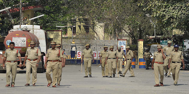 Indian police personnel patrol at the entrance to Gulf Oil Corporation Limited company (Explosives Division) in Hyderabad.