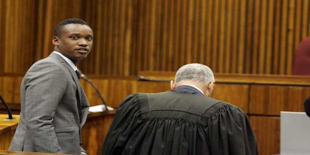 Duduzane Zuma with his lawyer Gary Mazaham at the Randburg Margistrate Court on November 4, 2014 in Johannesburg, South Africa. Zuma's was attending an inquest into a crash in which taxi passenger Phumzile Dube died after his Porsche hit the back of the taxi and the taxi overturned.