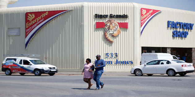 A couple leaves Tiger Brands factory shop in Germiston, Johannesburg, South Africa, March 5, 2018. REUTERS/Siphiwe Sibeko