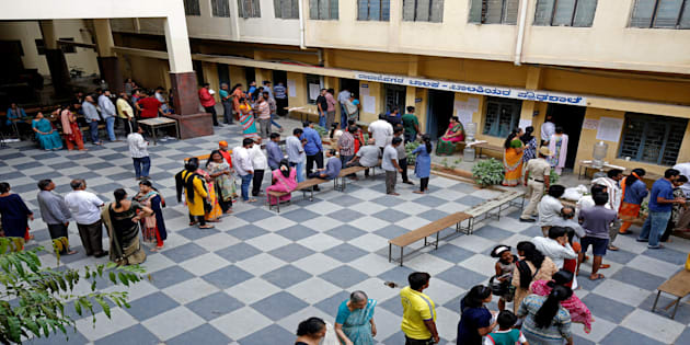 File photo of Voters waiting in queues to cast their ballot outside a polling station during the recently concluded Karnataka assembly elections.