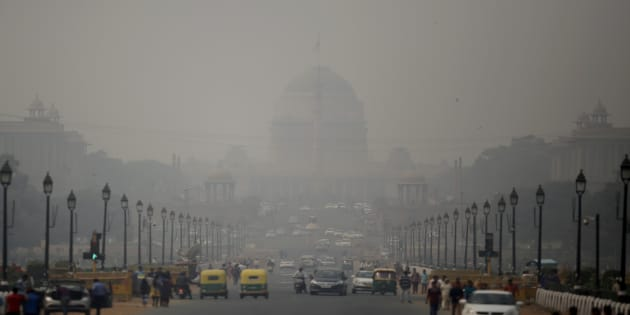 India's Rashtrapati Bhawan, or the Presidential Palace is partly visible due to smog as traffic plies on Rajapth, the ceremonial boulevard in New Delhi, India, Thursday, Nov. 8, 2018. T