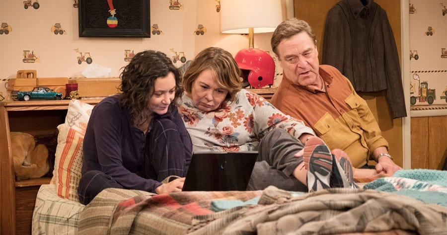 """ROSEANNE - """"Roseanne Gets the Chair"""" - Roseanne's clash with Darlene over how she's raising her kids - especially Harris - reaches a breaking point; while Dan tries to help Roseanne with her bad knee by getting her an elevator chair, which she refuses to use because she doesn't want to admit getting old, on the second episode of the revival of """"Roseanne,"""" TUESDAY, APRIL 3 (8:00-8:30 p.m. EDT), on The ABC Television Network. (ABC/Adam Rose)SARA GILBERT, ROSEANNE BARR, JOHN GOODMAN"""