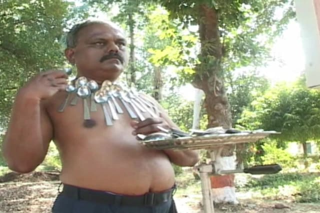 Incredible 'magnetic man' has unusual ability to attract metal objects to his body in central India