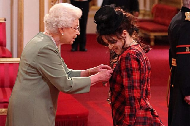 The Queen presented Helena Bonham Carter with her CBE in 2012 (Credit: PA)