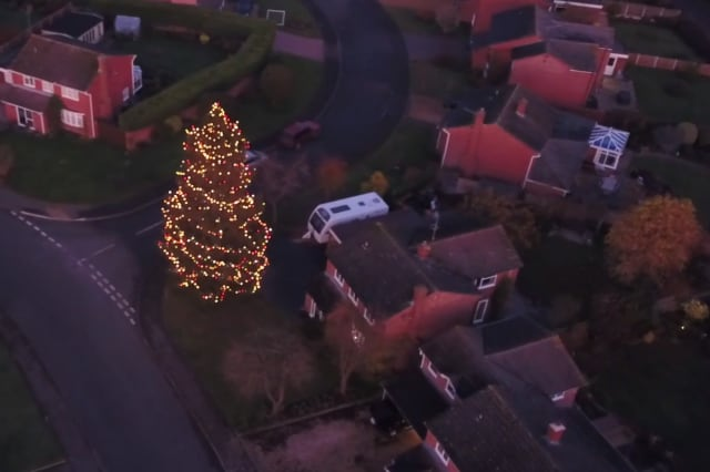 Britain's darkest village with no street lights becomes illuminated for Christmas after a couple decorate their old tree which grew to 52ft after planting it in 1978