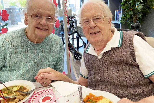 Devoted wife surprises dementia-stricken husband by moving into his care home after a month apart because she 'can't live without him'