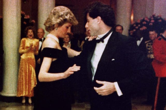 NOVEMBER 1985 FILE PHOTO- Princess Diana is shown wearing a Victor Edelstein gown as she dances at a November 9, 1985 White House dinner with actor John Travolta. The ink-blue Edelstein gown sold for $222,500 during an auction at Christie's auction house in New York June 25, the highest price paid for any one of the 79 gowns worn by the Princess, and auctioned to raise funds for AIDS and cancer charities in Britain and the United States.  DIANA
