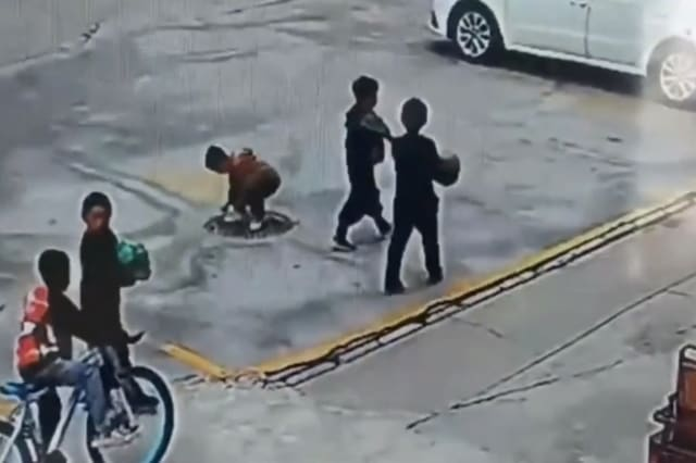 Manhole explosion sends Chinese boy flying into air after he throws firecracker inside