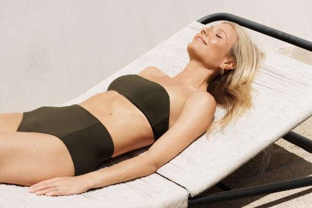 Gwyneth Paltrow models Goop's first swimwear collection
