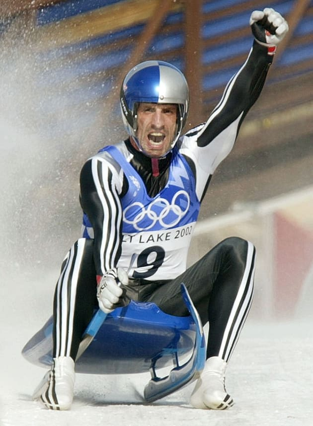 Markus Prock of Austria celebrates after winning the silver medal in the luge competition in Park City, at the Salt Lake 2002 Olympic Winter Games, February 11, 2002. [Armin Zoeggeler of Italy finished first with an overall time of two minutes, 57.941 seconds.]