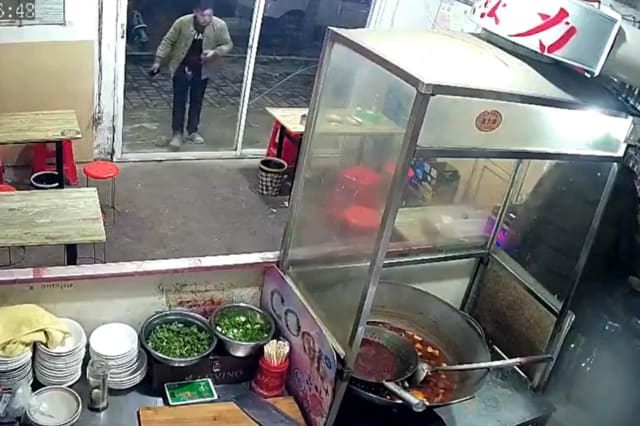 Restaurant's glass door shatters after man walks straight into it in central China