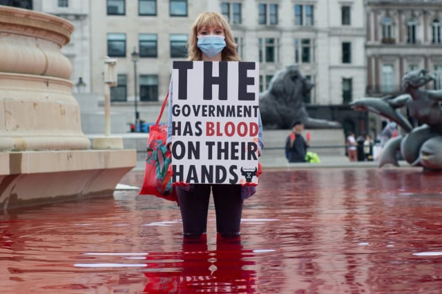 Two arrested after protesters dye Trafalgar Square fountains red