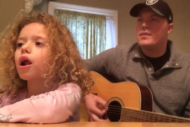 A man and his Goddaughter sing an autism-inspired song for a family member