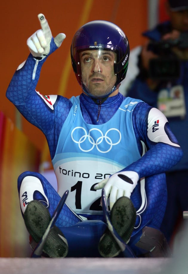 Wilfried Huber of Italy gestures during an official men luge training run for the Torino 2006 Winter Olympic Games competition in Cesana Pariol, Italy, February 8, 2006. REUTERS/Jean-Paul Pelissier