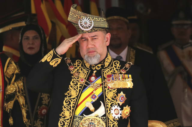 FILE - In this July 17, 2018, file photo, Malaysian King Sultan Muhammad V salutes during the national anthem at the opening of the 14th parliament session at the Parliament house in Kuala Lumpur, Malaysia.  Muhammad V has abdicated in an unexpected and rare move, just after two years on the throne. The palace said in a statement on Sunday, Jan. 6, 2019, that Sultan Muhammad V, 49, has resigned with immediate effect, cutting short his five-year term, without giving any reasons. Sultan Muhammad V, ruler of northeast Kelantan state, was installed in December 2016 as one of the country's youngest constitutional monarchs. (AP Photo/Yam G-Jun, File)