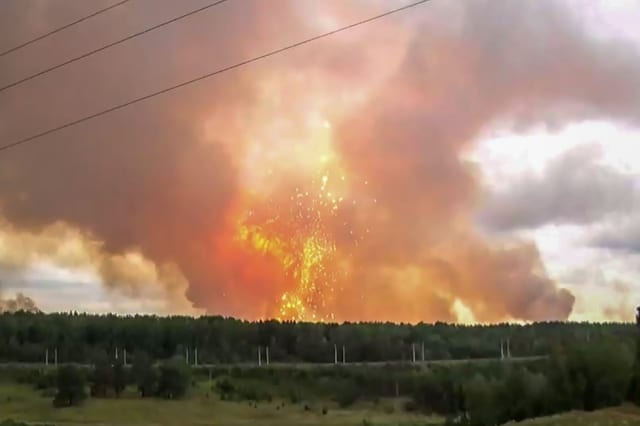 Russia explosions: 100,000 residents told to leave their homes after powerful blasts at military depot in Siberia