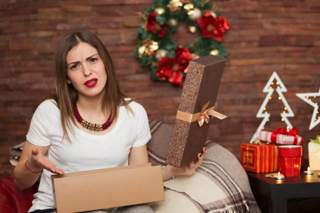 Pretty woman opening Christmas presents