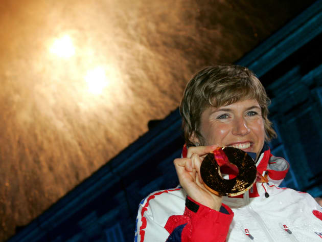 Gold medallist Katerina Neumannova of the Czech Republic celebrates after receiving her medal for winning the women's 30km cross country race at the Torino 2006 Winter Olympic Games in Turin, Italy February 24, 2006.