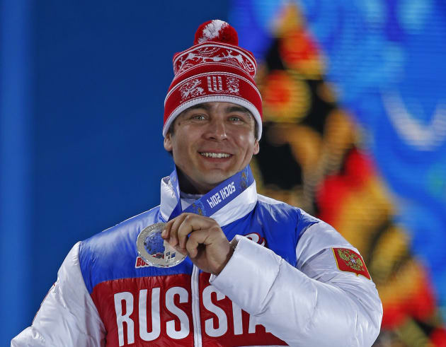 Silver medalist Albert Demchenko of Russia holds up his medal during the medal ceremony for the men's singles luge event at the Sochi 2014 Winter Olympics February 10, 2014.   REUTERS/Shamil Zhumatov (RUSSIA  - Tags: OLYMPICS SPORT LUGE)