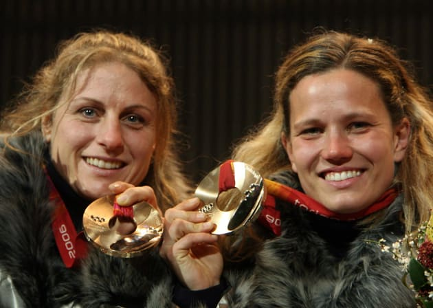 Bronze medallists Gerda Weissensteiner(R) and Jennifer Issaco of Italy celebrate after receiving their medals for the bobsleigh women's two man event at the Torino 2006 Winter Olympic Games in Turin, Italy February 22, 2006.